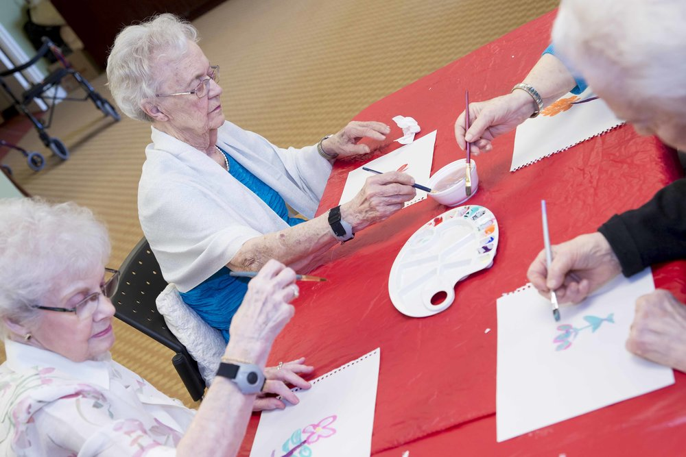 Seniors doing painting at Queens Avenue Retirement Residence, Oakville