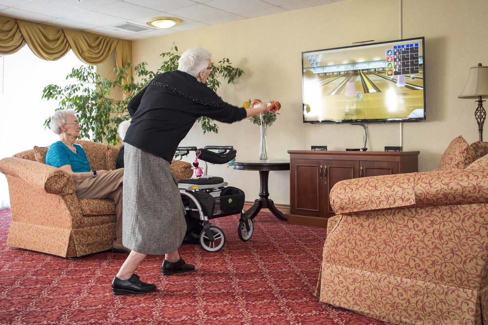 Grandma playing video game at Queens Avenue Retirement Residence, Oakville