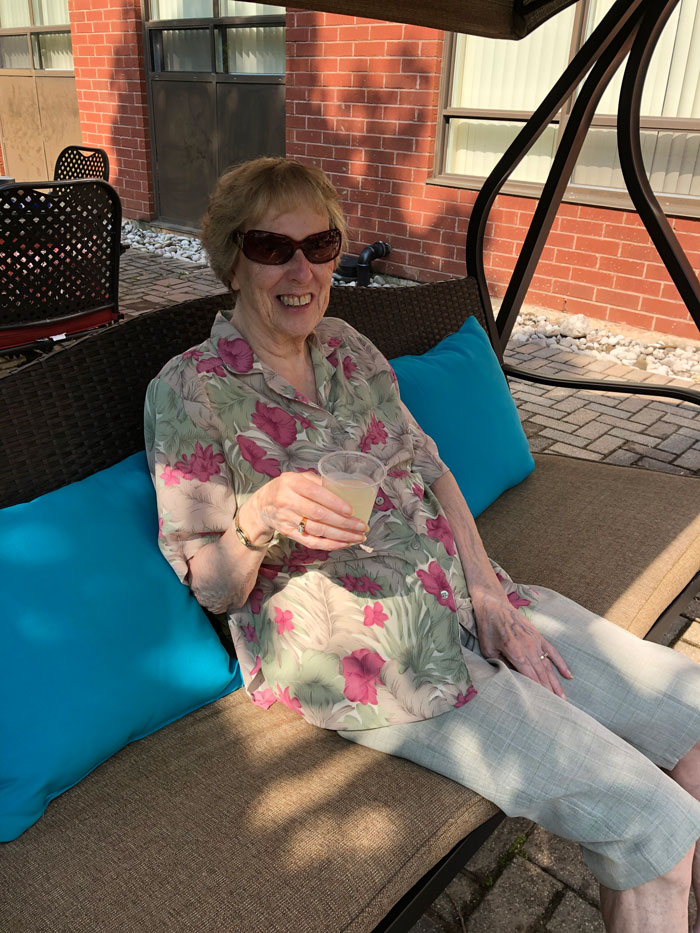 We have resident Patricia have some fresh juice on the swing