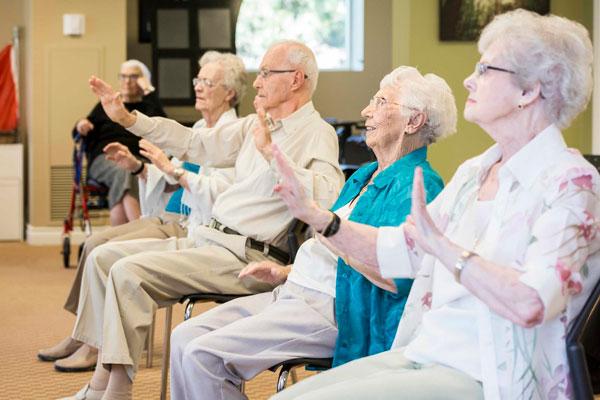 Seniors enjoying with each other at Oakville Retirement Residence